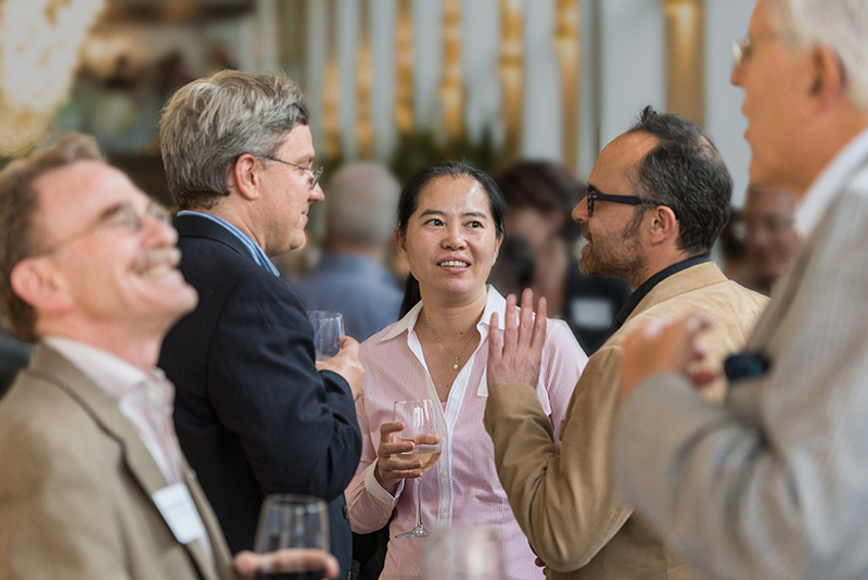 LSI Leadership Council and Scientific Advisory Board members mingle with faculty