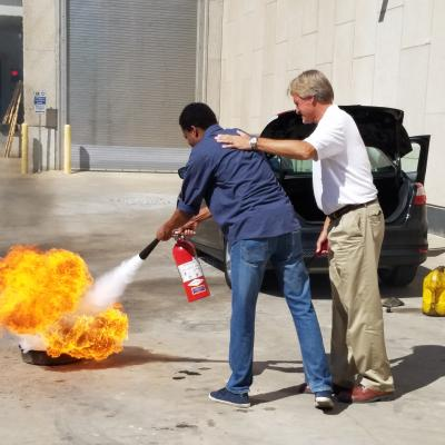 Person putting out a fire