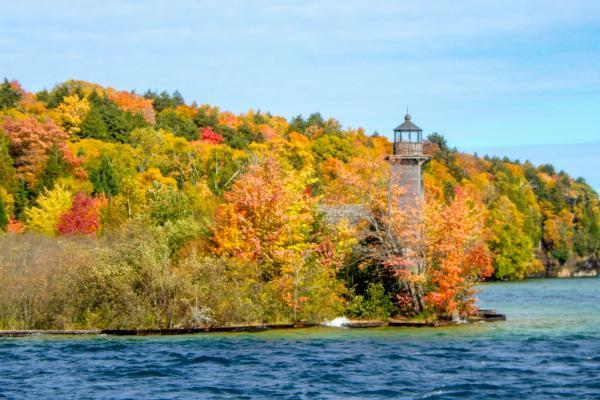 lighthouse and fall trees
