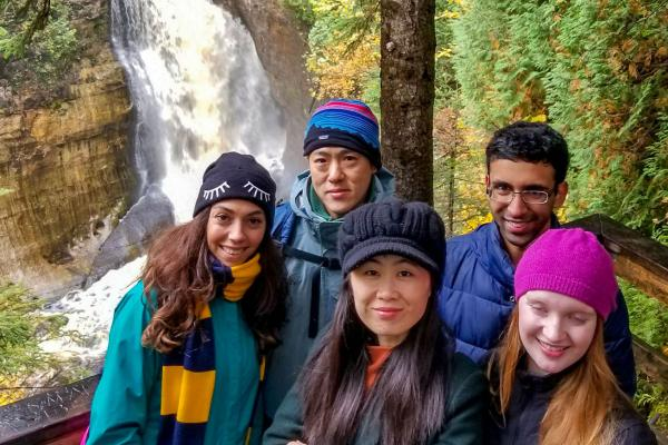 Lee lab in front of waterfall