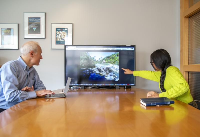 David Sherman and Rosa Vasquez discuss images of the Boiling River