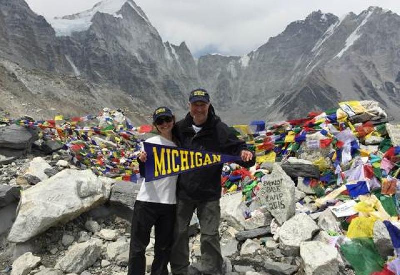 David Sherman and his daughter hold a U-M flag on Mt. Everest
