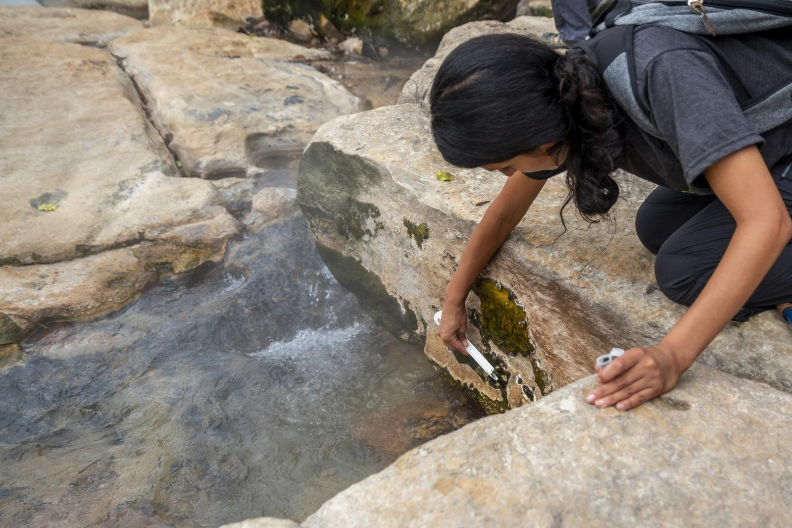 Rosa Vasquez collects samples from the Boiling River