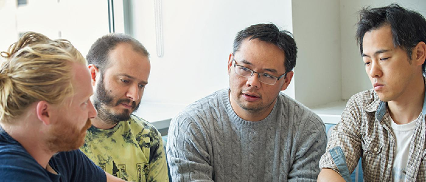 Lee lab members discussing a paper