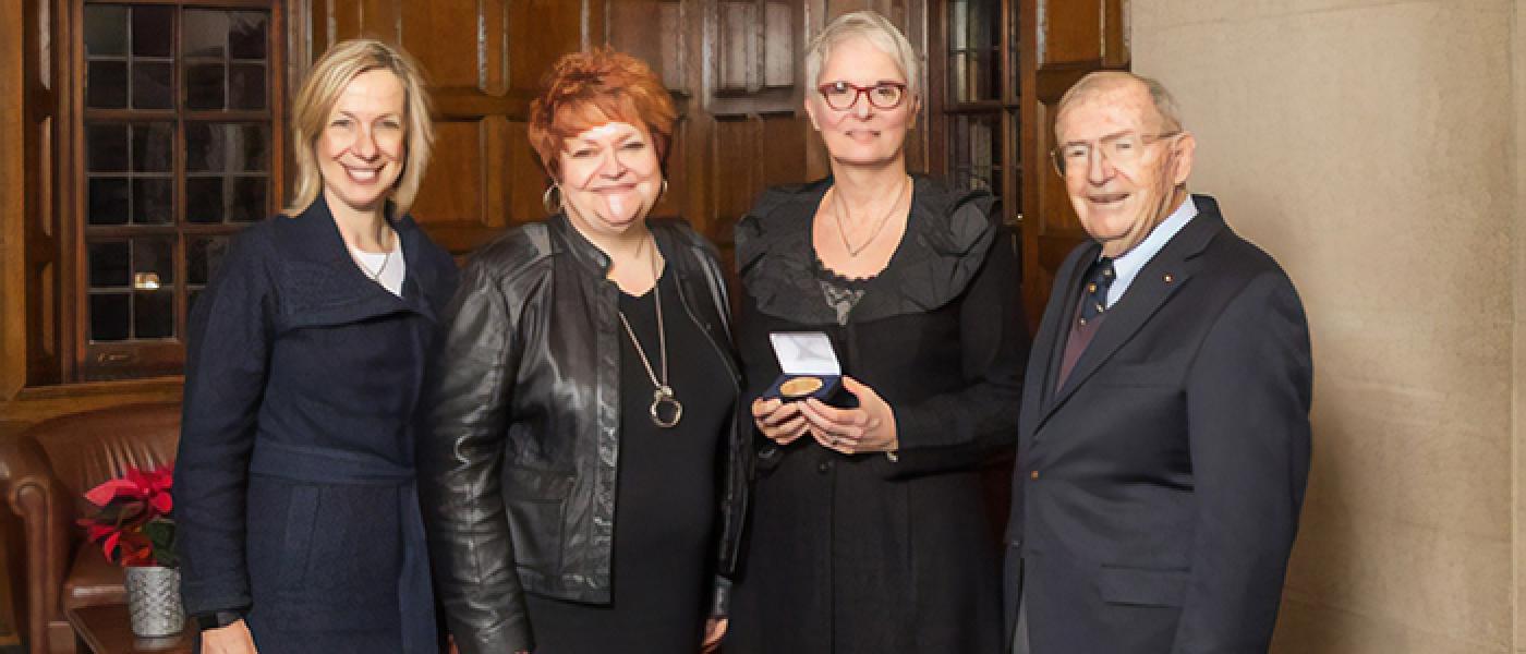 Carole Parent posing with Michigan Medicine leaders