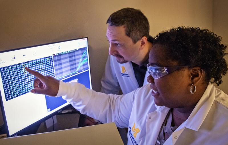Two researchers work together in the Center for Chemical Genomics